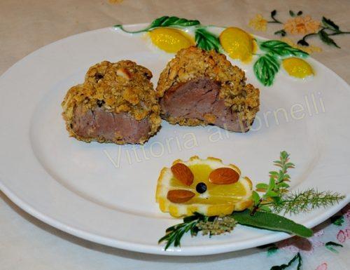 Filetto di maiale in crosta di frutta secca e miele
