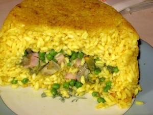 timballo di riso carciofi e piselli fetta