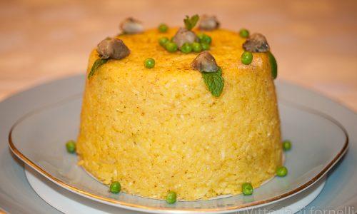 Timballo di riso con carciofi e piselli