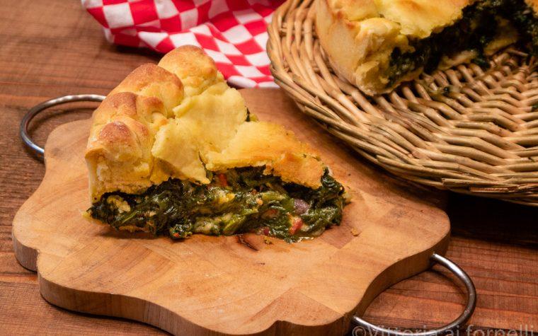 Pizza rustica ripiena di bietole con olive e mozzarella