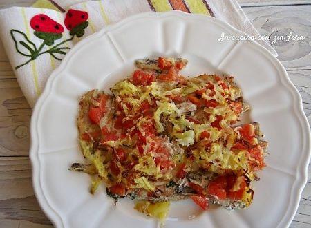 Alici al forno con patate e pomodori
